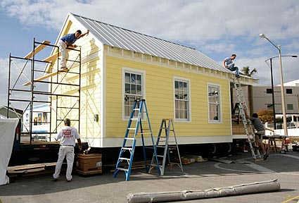 construction crew puts finishing touches on katrina cottage 1 photos by sandy sorlien - Katrina Cottage Plans
